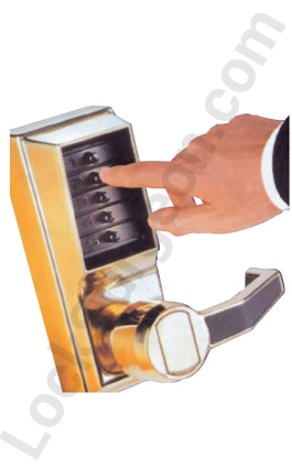 finger pushing buttons on a manual pushbutton entry handle